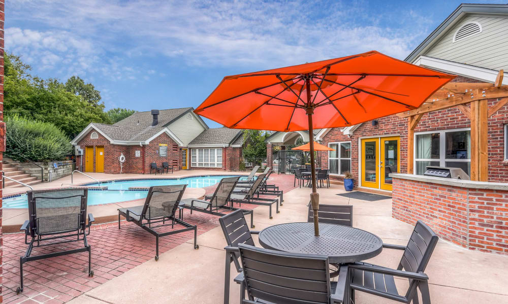 Dinning table close to the pool at Keystone Apartments in Northglenn, Colorado