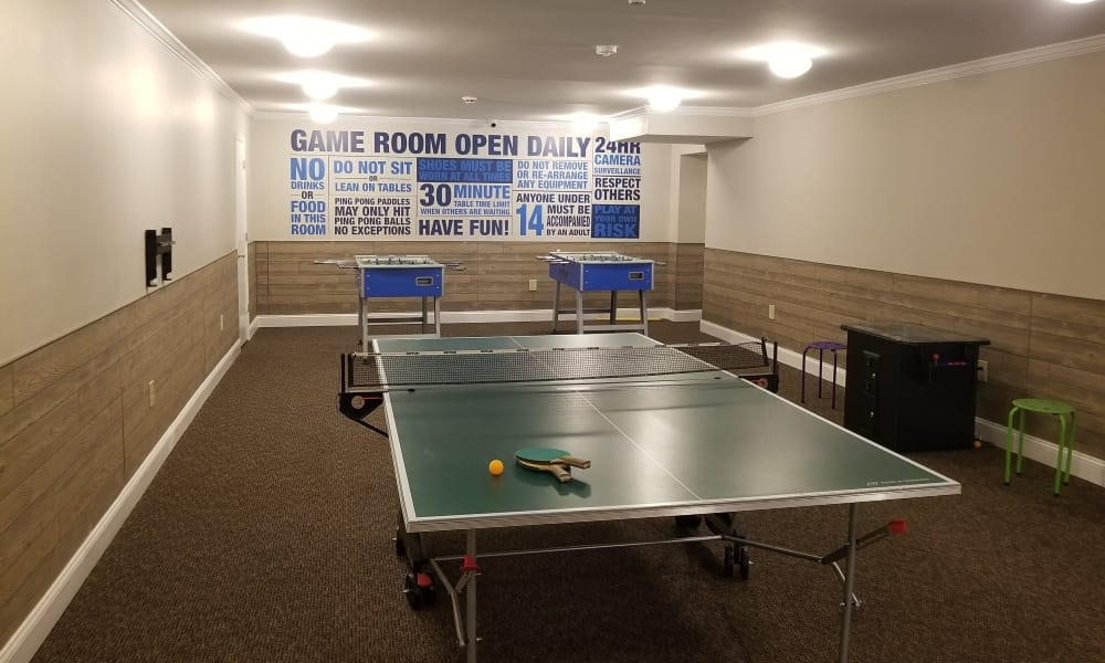Enjoy Apartments with a Clubhouse w/ a Ping Pong Table at Kingswood Apartments & Townhomes