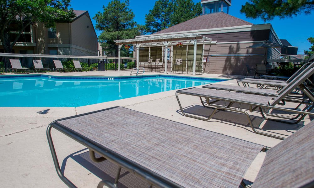 Poolside seating at Eagle Point Apartments in Tulsa, Oklahoma