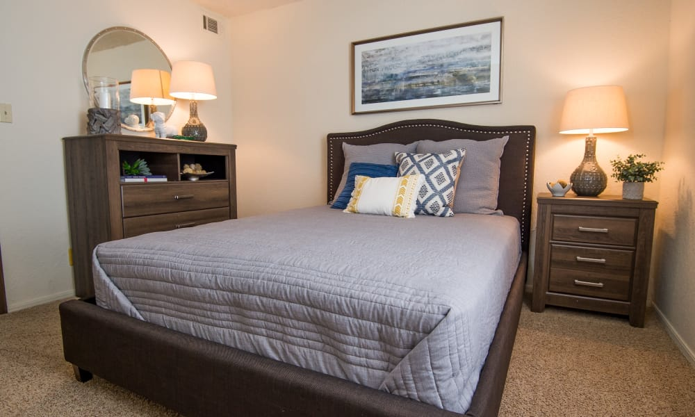 Large bed in a bedroom at Eagle Point Apartments in Tulsa, Oklahoma