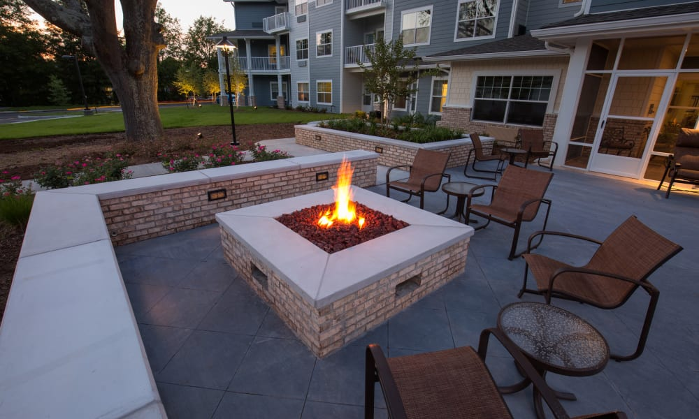Outdoor seating around the firepit at Springwood Landing Gracious Retirement Living in Vancouver, Washington