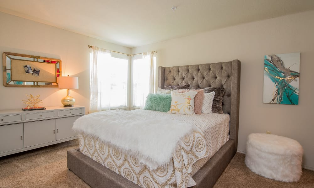 Well-lit bedroom at Crown Chase Apartments in Wichita, Kansas