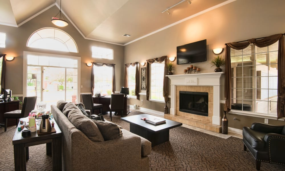 Clubhouse with comfortable fireside seating at Crown Chase Apartments in Wichita, Kansas