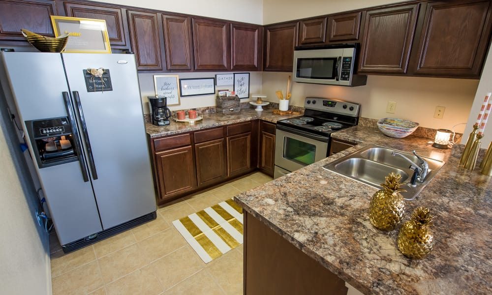 Kitchen with stainless steel appliances at Fountain Lake in Edmond, Oklahoma