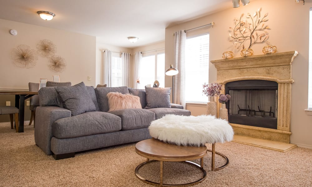 Living room with a fireplace at Fountain Lake in Edmond, Oklahoma