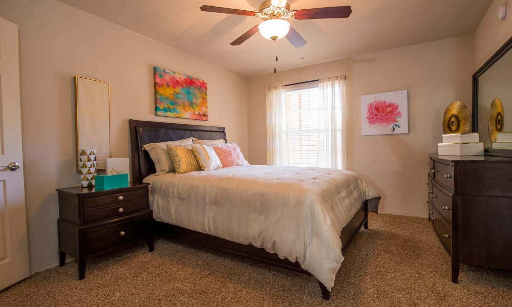 Well-lit bedroom at Fountain Lake in Edmond, Oklahoma