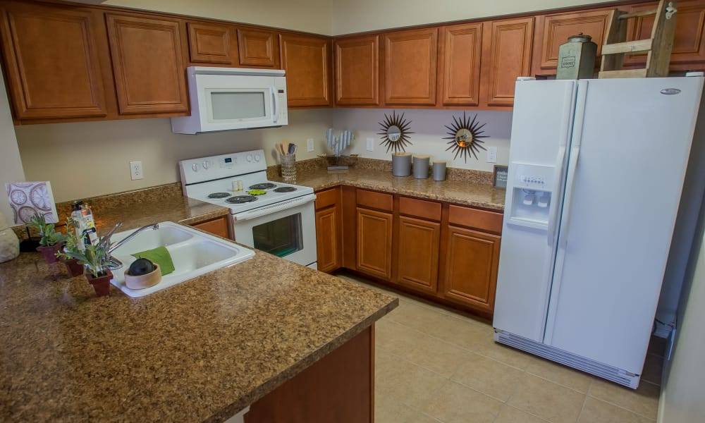 Kitchen with white appliances at Fountain Lake in Edmond, Oklahoma
