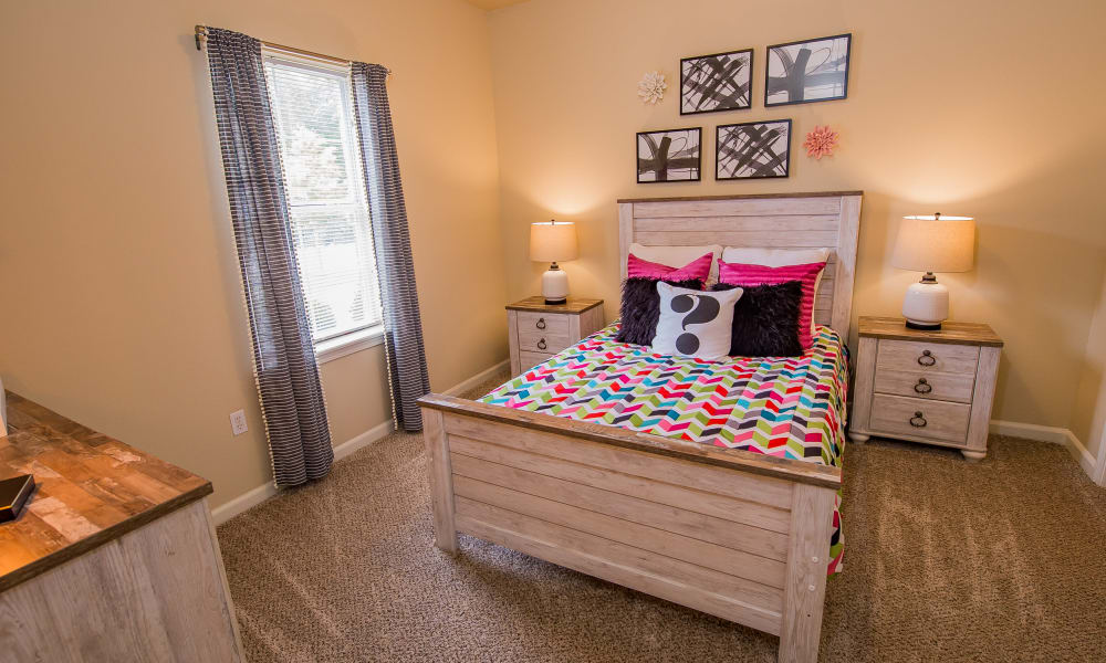 Playfully furnished bedroom at Lexington Park Apartment Homes in North Little Rock, Arkansas