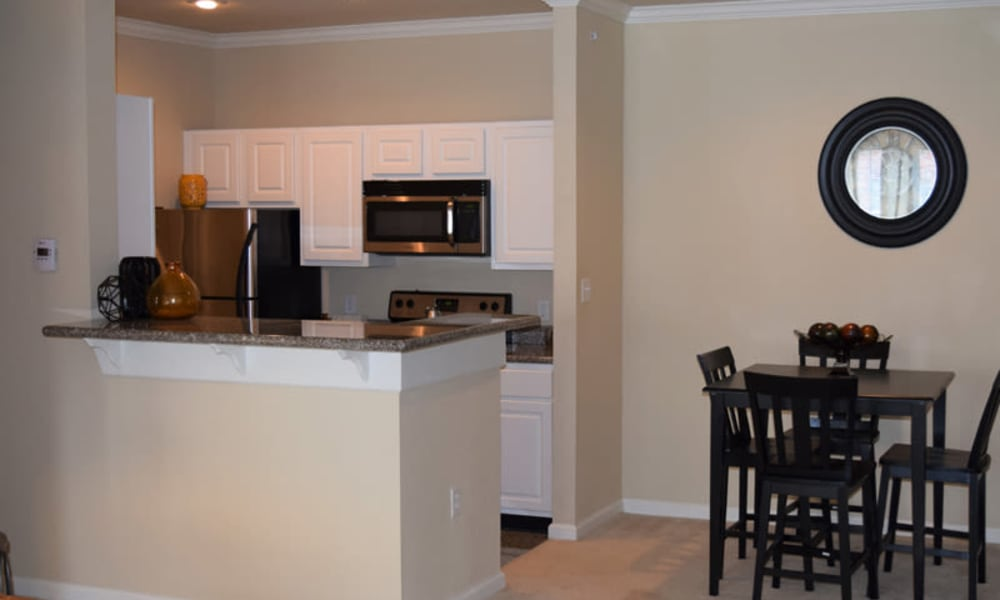 Open kitchen and dining room at Lexington Park Apartment Homes in North Little Rock, Arkansas