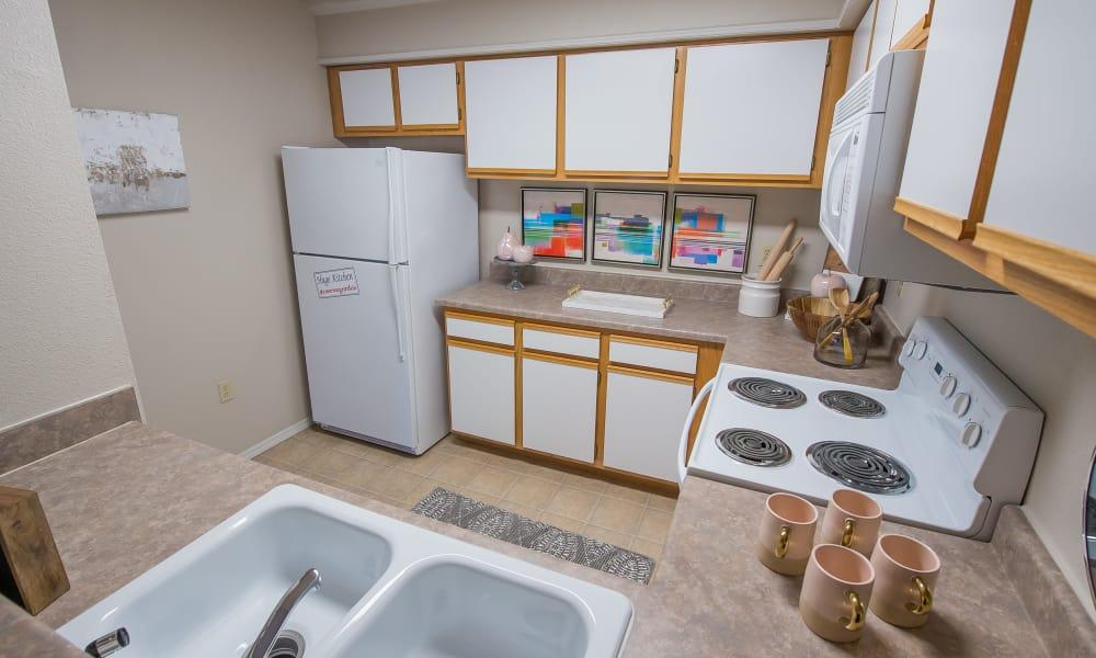 Apartment kitchen with plenty of cabinet space at Newport Wichita in Wichita, Kansas