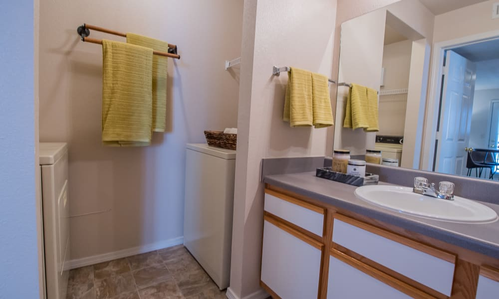Bathroom with a full size washer and dryer at Newport Wichita in Wichita, Kansas