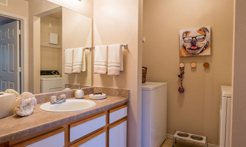 Clean bathroom with a washer and dryer at Newport Wichita in Wichita, Kansas