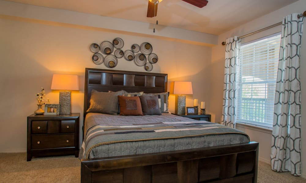 Elegant bedroom at Nickel Creek Apartments in Tulsa, Oklahoma