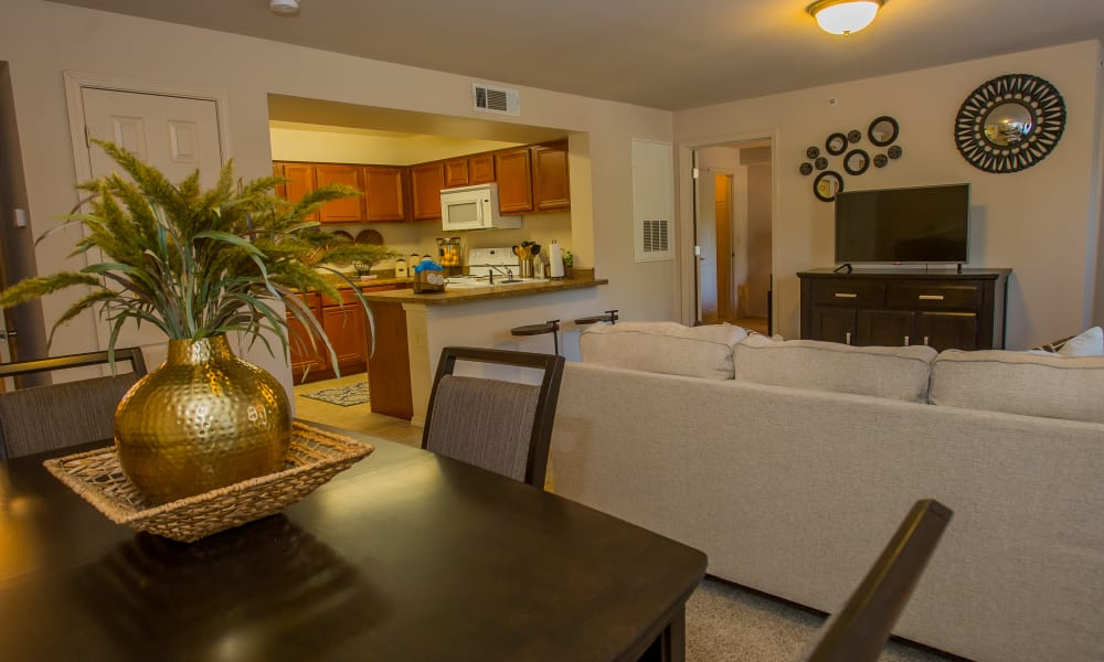Living room with a view of the kitchen at Nickel Creek Apartments in Tulsa, Oklahoma