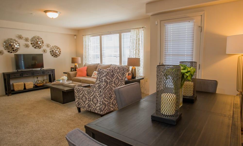 Carpeted living room at Nickel Creek Apartments in Tulsa, Oklahoma