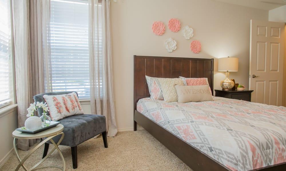 Well-lit bedroom at Nickel Creek Apartments in Tulsa, Oklahoma