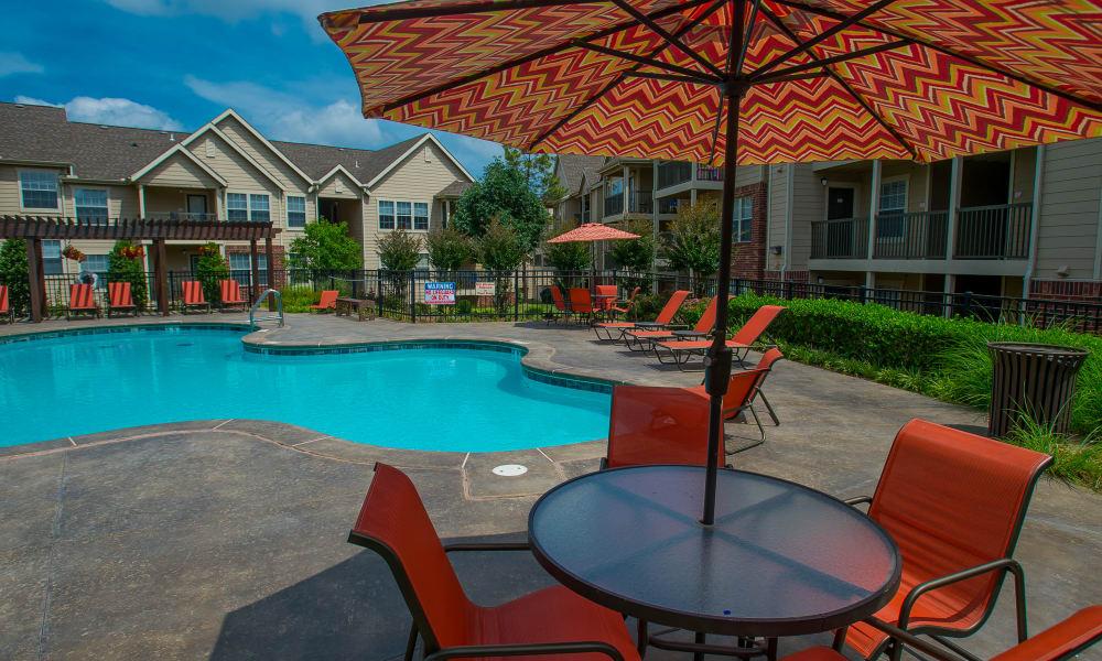 A gated community pool at Nickel Creek Apartments in Tulsa, Oklahoma