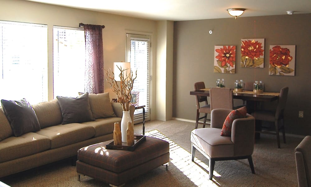Carpeted living room with a patio access at Park at Coulter in Amarillo, Texas