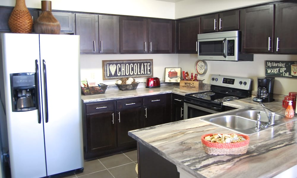 An apartment kitchen at Park at Coulter in Amarillo, Texas