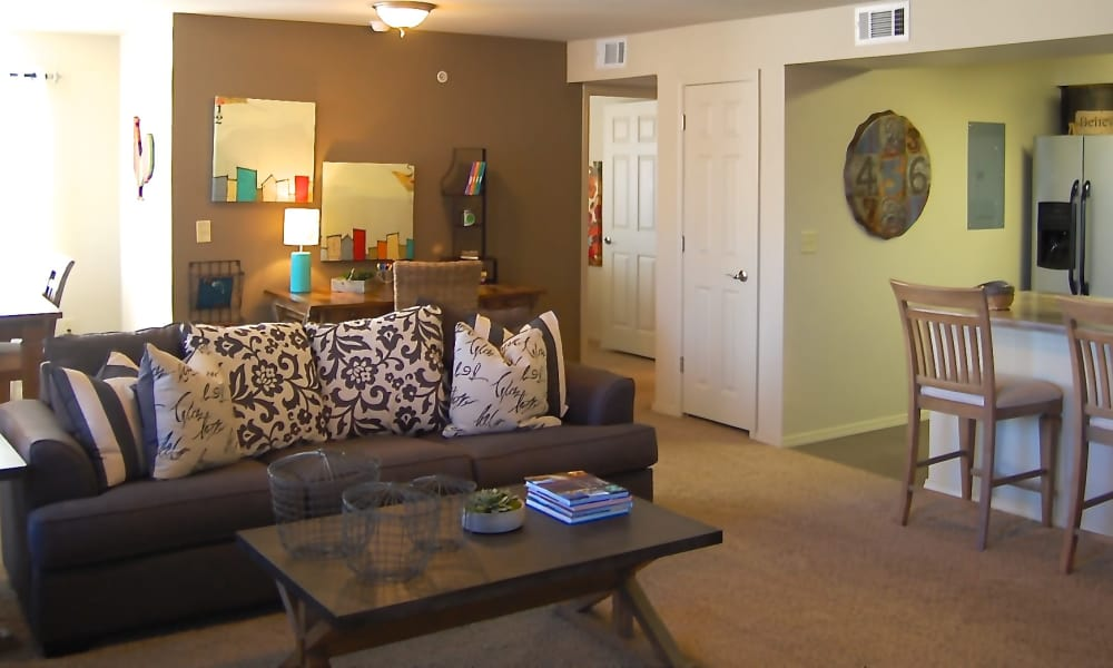 An apartment living room with couch and table at Park at Coulter in Amarillo, Texas
