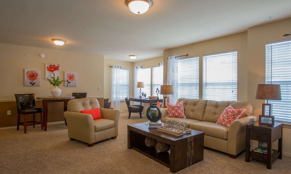 Spacious living room with many windows at Park at Mission Hills in Broken Arrow, Oklahoma