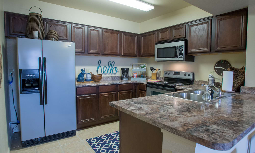 Fully equipped kitchen at Park at Mission Hills in Broken Arrow, Oklahoma