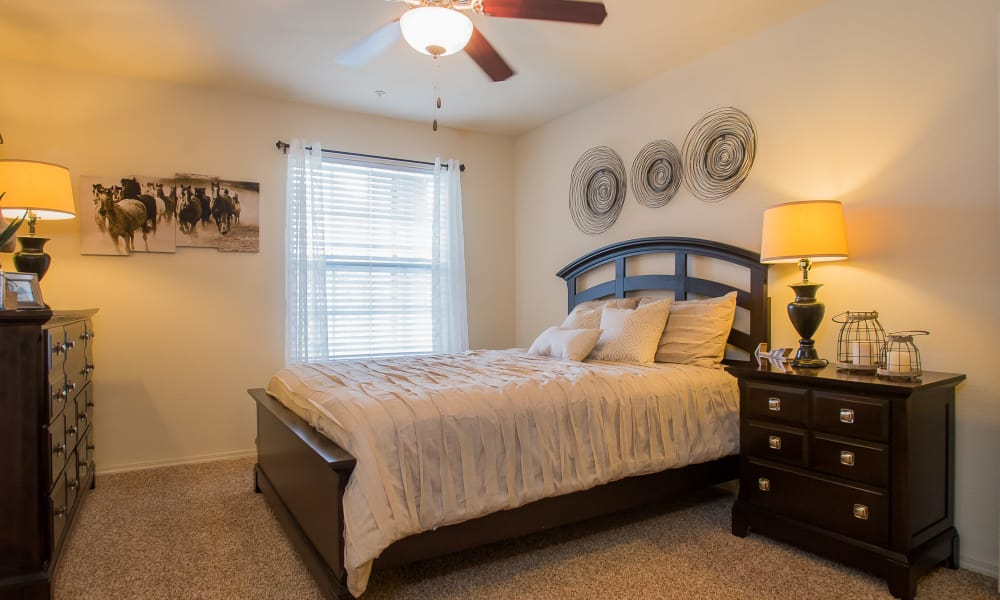 Bedroom with a ceiling fan at Park at Mission Hills in Broken Arrow, Oklahoma