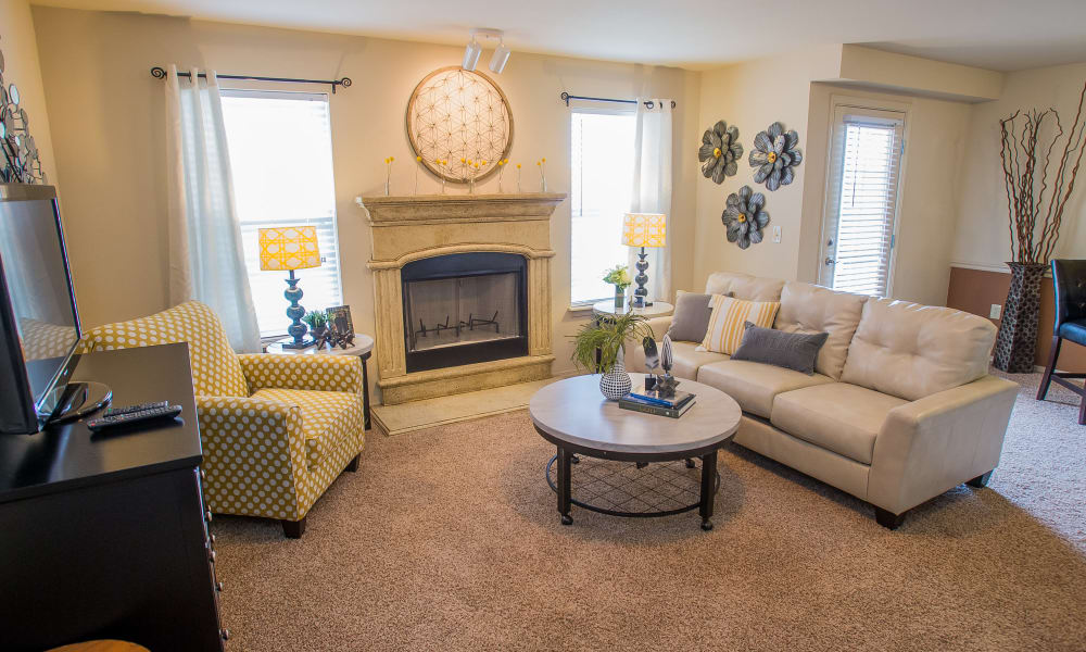 Carpeted living room with a fireplace at Park at Mission Hills in Broken Arrow, Oklahoma