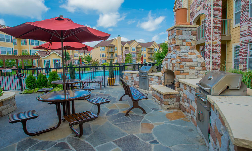 Outdoor patio with fireplace at Park at Mission Hills in Broken Arrow, Oklahoma