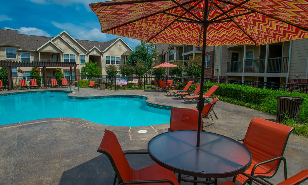 The Pool with a picnic table at Nickel Creek Apartments in Tulsa, Oklahoma