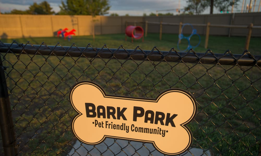 Sign for the community dog park at Portofino Apartments in Wichita, Kansas
