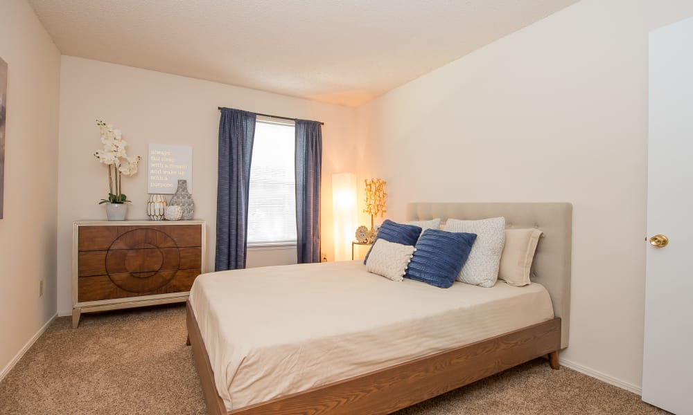 Well-lit bedroom at Raintree Apartments in Wichita, Kansas