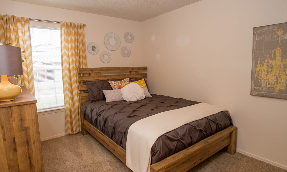 Bright bedroom at Tammaron Village Apartments in Oklahoma City, Oklahoma