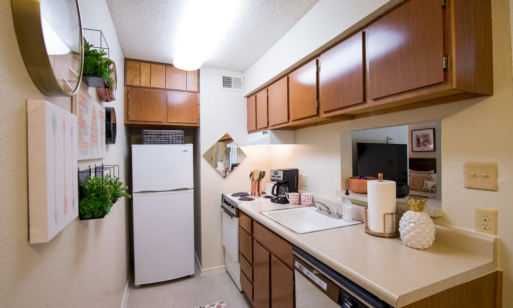 A cozy kitchen at Sunchase Apartments in Tulsa, Oklahoma