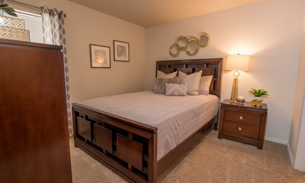 Bed and cabinetry at Sunchase Apartments in Tulsa, Oklahoma