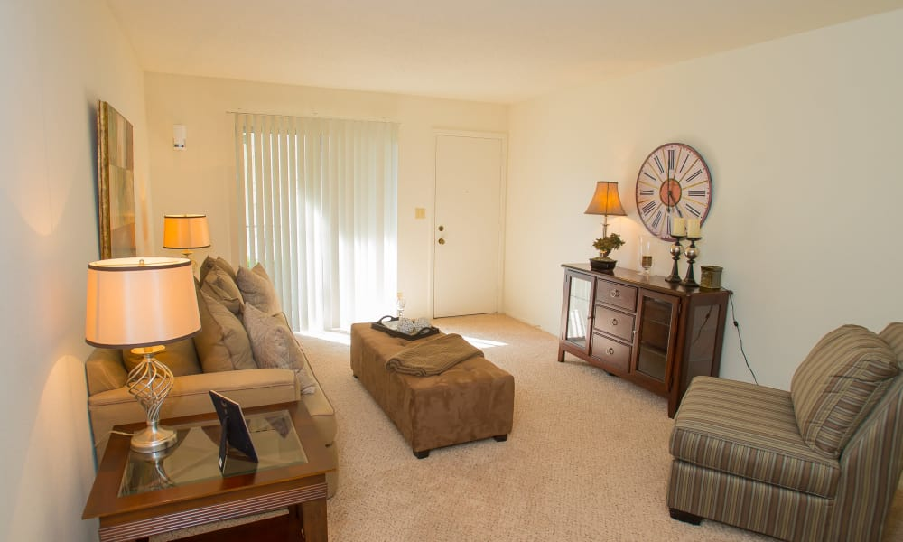 Living room with patio access at Riverpark Apartments in Tulsa, Oklahoma