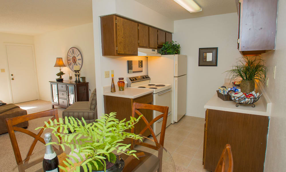 Dining room with a view of the kitchen at Riverpark Apartments in Tulsa, Oklahoma