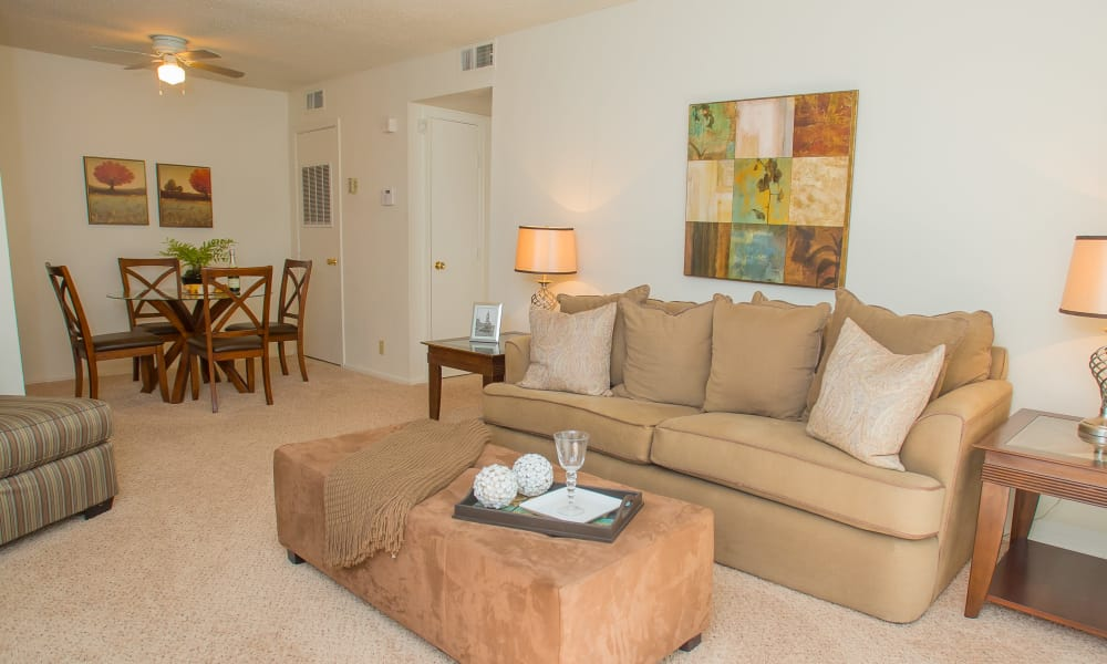 Carpeted living room at Riverpark Apartments in Tulsa, Oklahoma