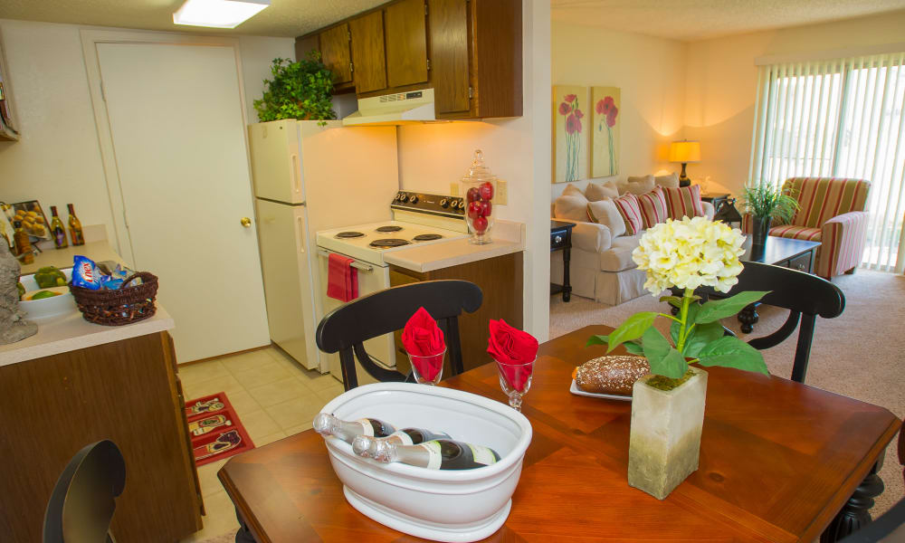 Kitchen and dining area at Riverpark Apartments in Tulsa, Oklahoma