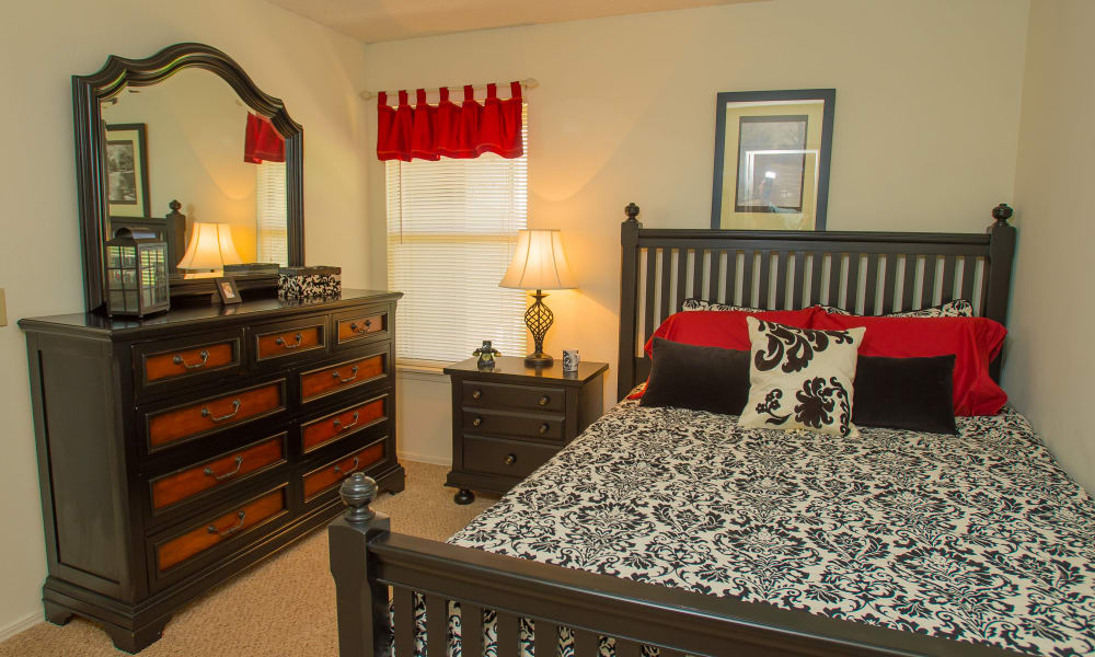 A well decorated bedroom at Riverpark Apartments in Tulsa, Oklahoma