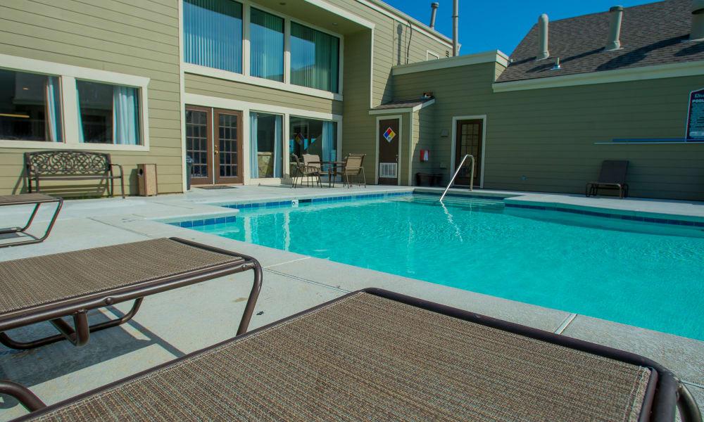 Poolside seating at Riverpark Apartments in Tulsa, Oklahoma