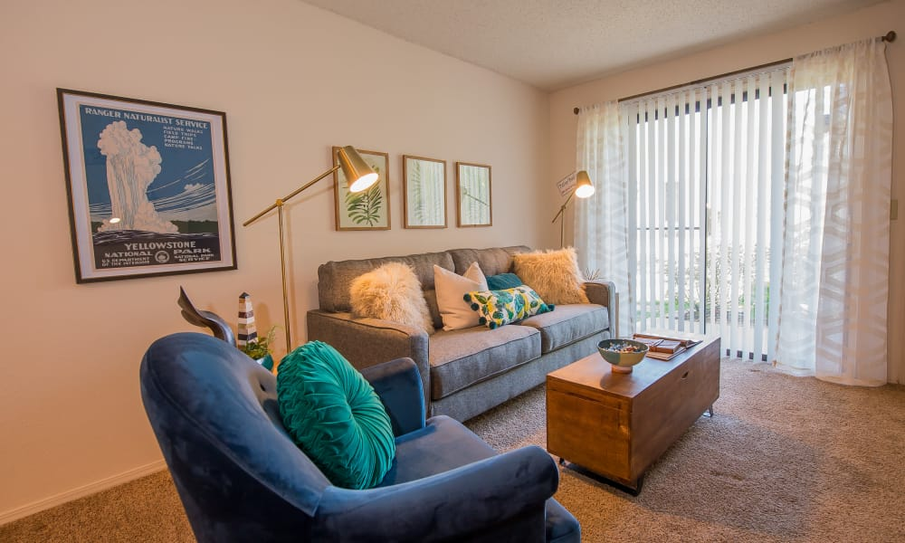 Living room and dining room at Silver Springs Apartments in Wichita, Kansas