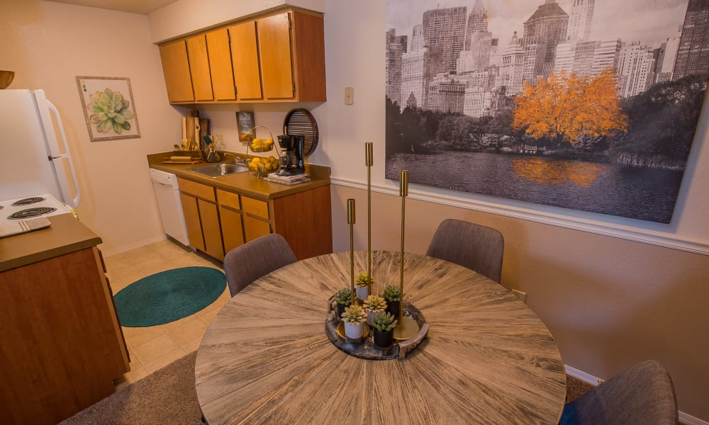 Dining table and kitchen at Silver Springs Apartments in Wichita, Kansas