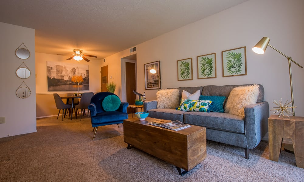 Well-lit living room at Silver Springs Apartments in Wichita, Kansas