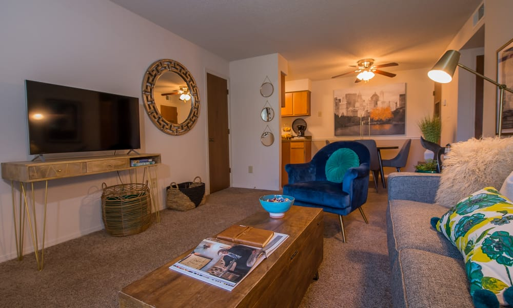 Living room with patio access at Silver Springs Apartments in Wichita, Kansas