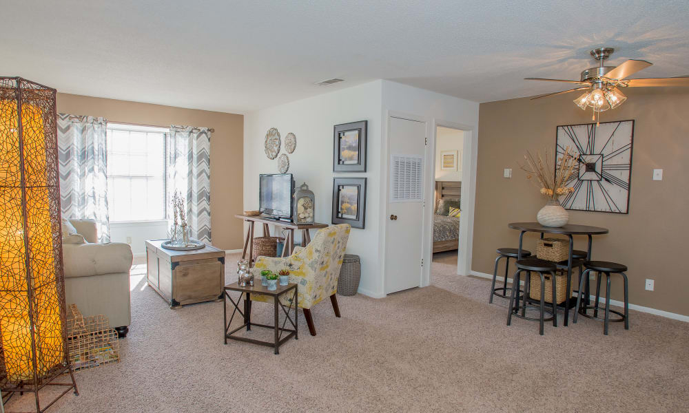 Spacious open-concept living area in model home at The Greens of Bedford in Tulsa, Oklahoma