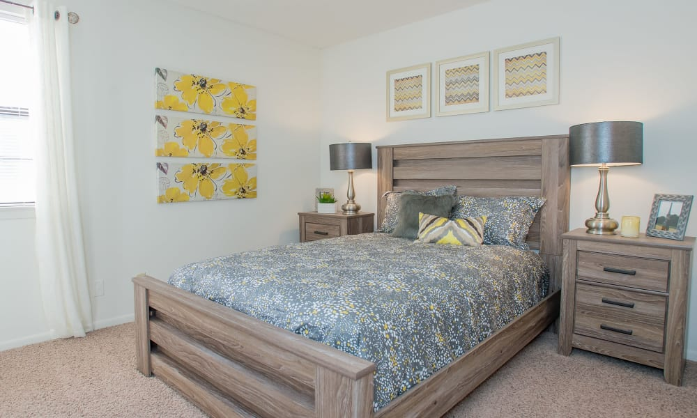 Well-decorated bedroom in model home at The Greens of Bedford in Tulsa, Oklahoma