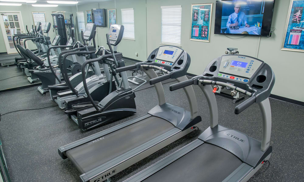 Treadmills and cardio machines in the fitness center at The Greens of Bedford in Tulsa, Oklahoma