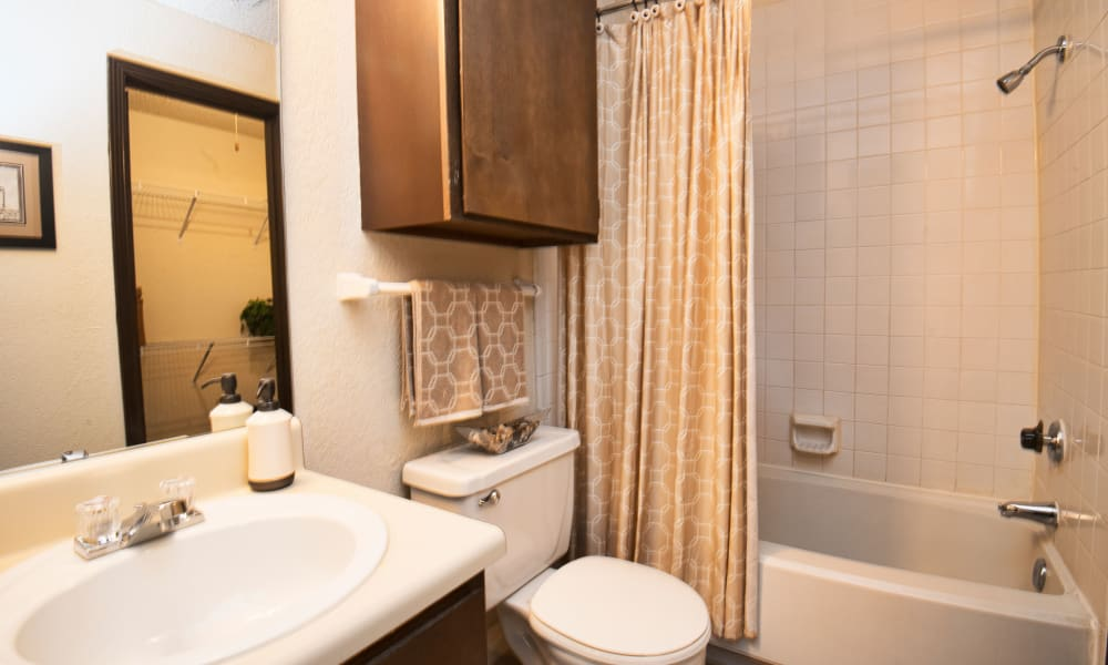 Bathroom with an extra cabinet at Aspen Park Apartments in Wichita, Kansas