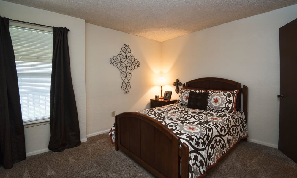 Bedroom with a view at Aspen Park Apartments in Wichita, Kansas
